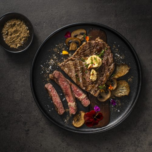 Spiced Bison Ribeye with Miso Butter and Red Wine Mushroom Sauce