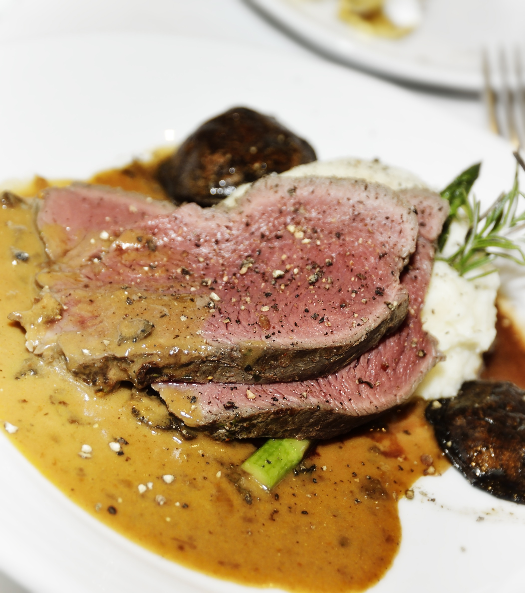 Marinated Bison Sirloin Tip Roast with Herbs and Wine article image