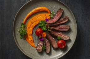 Bison Striploin with Romesco Sauce and Rapini article image